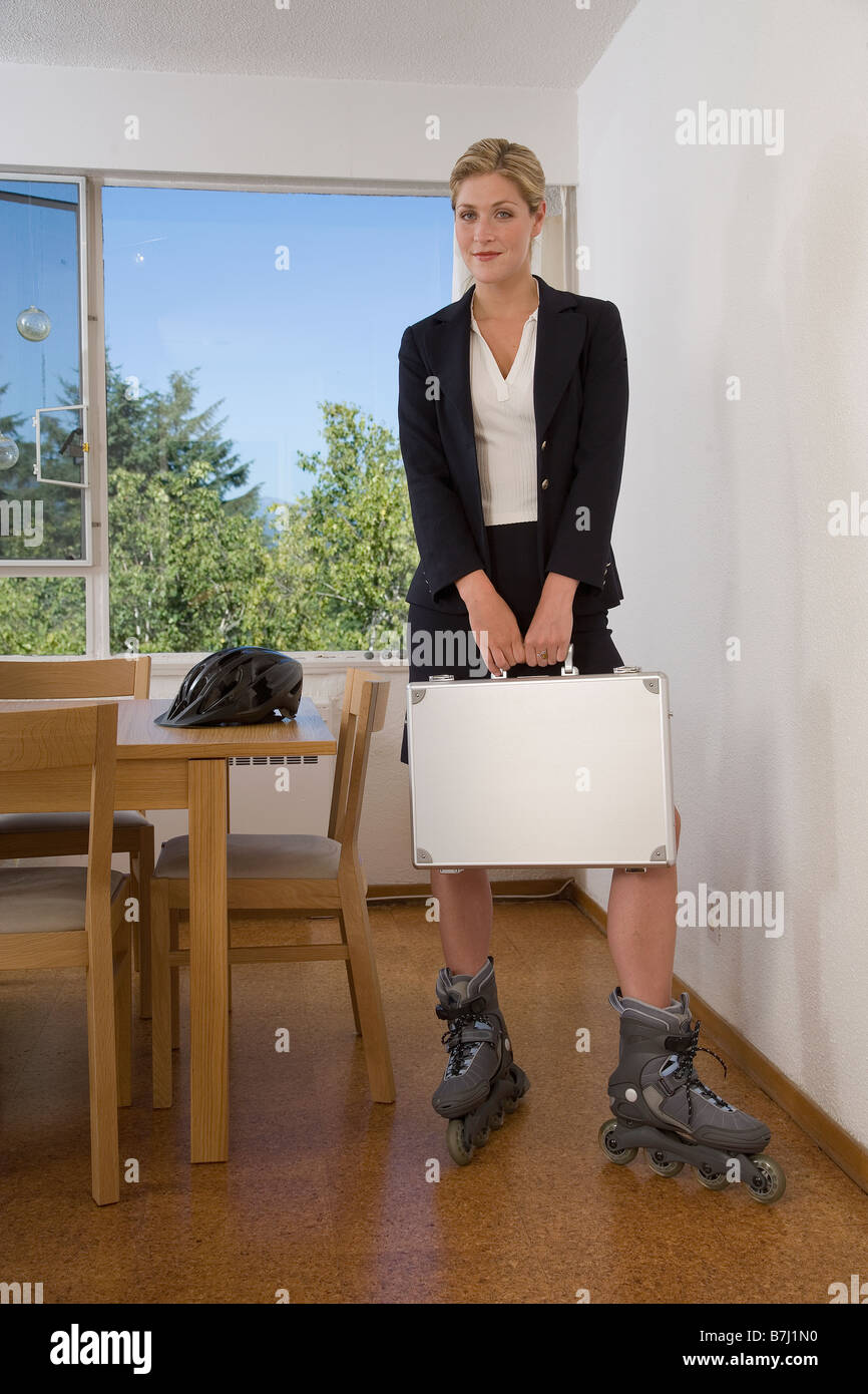 woman roller blading work briefcase stockfotos woman. Black Bedroom Furniture Sets. Home Design Ideas