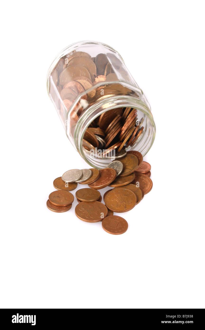Englische Münzen aus einem Marmeladenglas. Stockbild