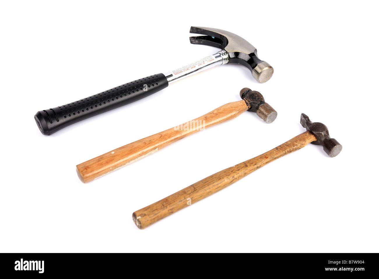 Drei verschiedene Arten von Hammer vor einem weißen Hintergrund Stockbild