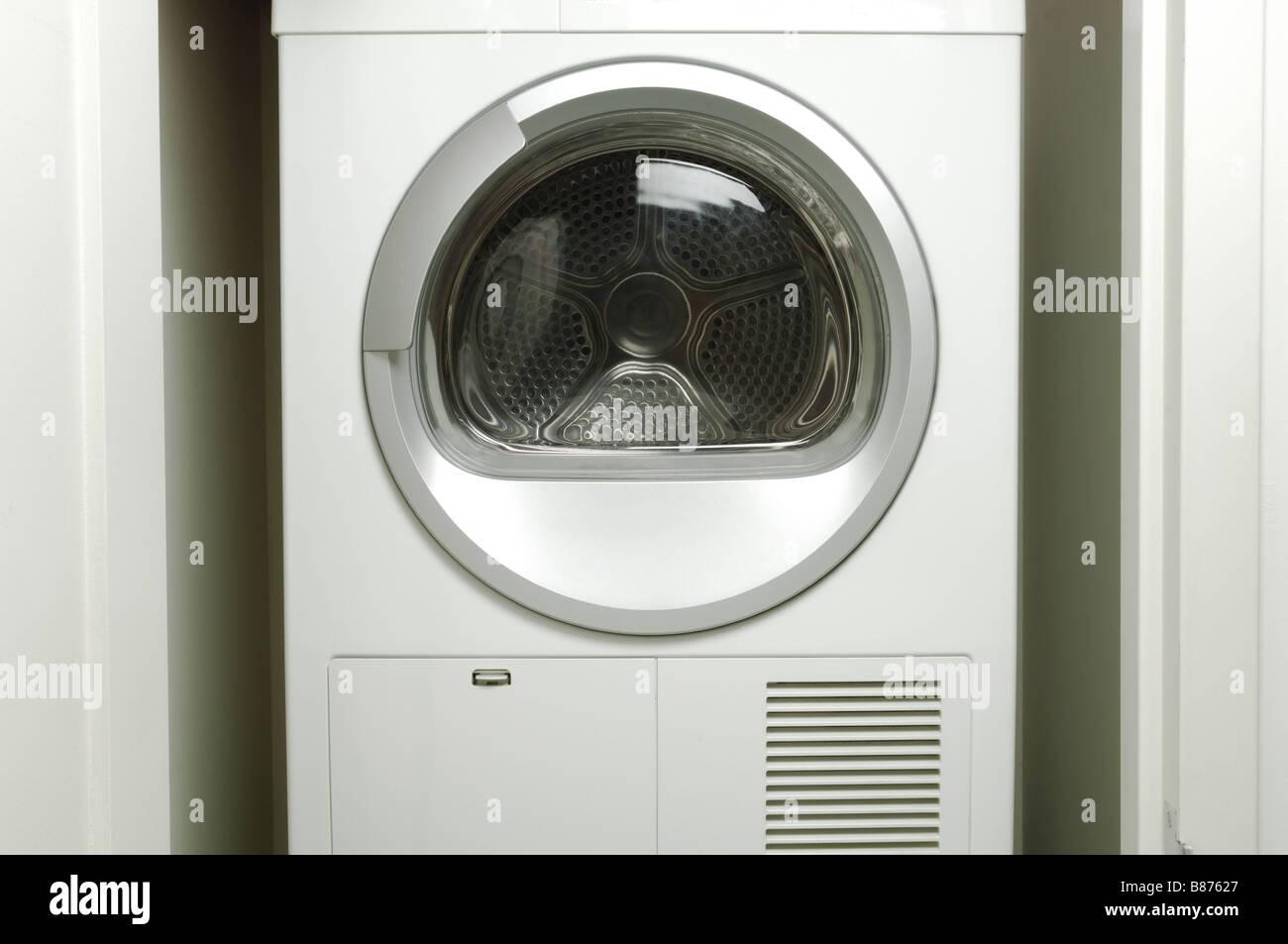 Eine leere Waschmaschine Wäschetrockner Stockbild