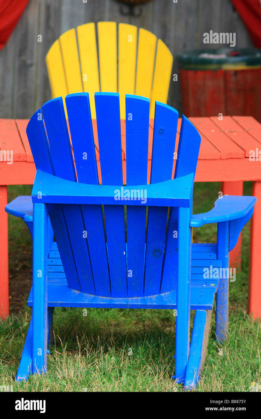 Colorful Wooden Adirondack Chairs Stockfotos & Colorful Wooden ...