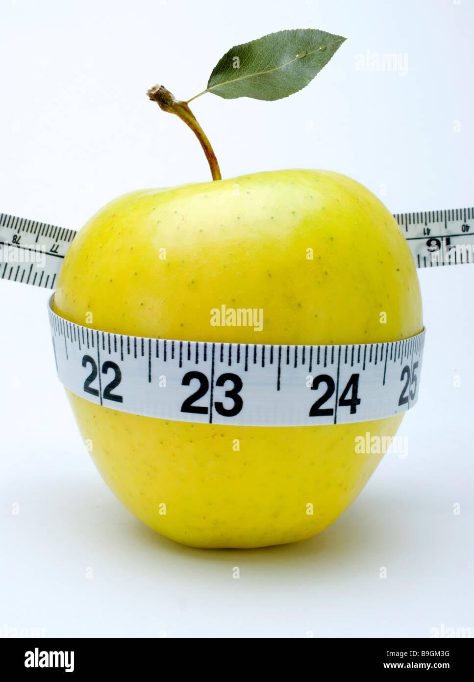 Apfel-Maßband Stockbild