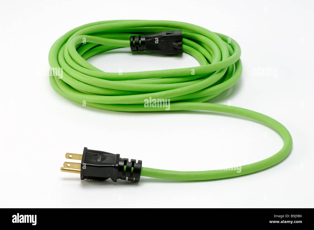 Ein aufgerollter grün elektrische Strom Verlängerungskabel mit zwei ...