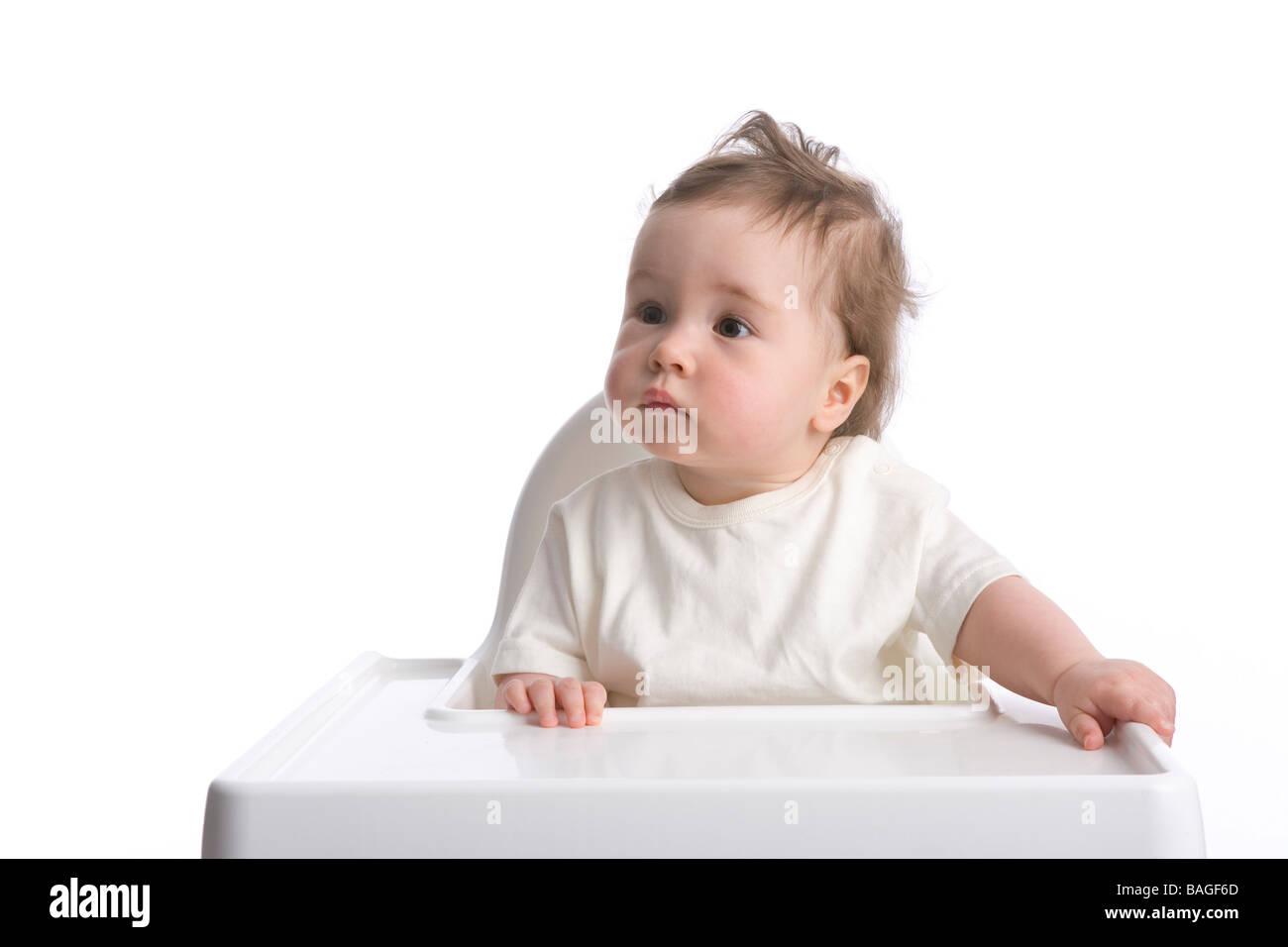 Kleinkind Mädchen in einer Bucht-Stuhl Stockbild
