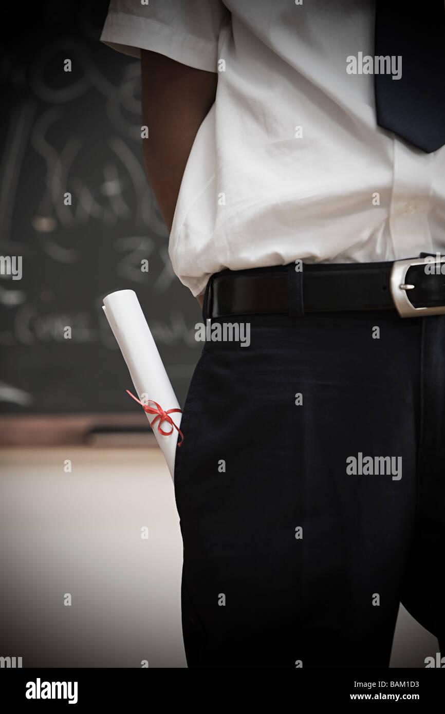 Student Mit Schriftrolle In Tasche Stockbild
