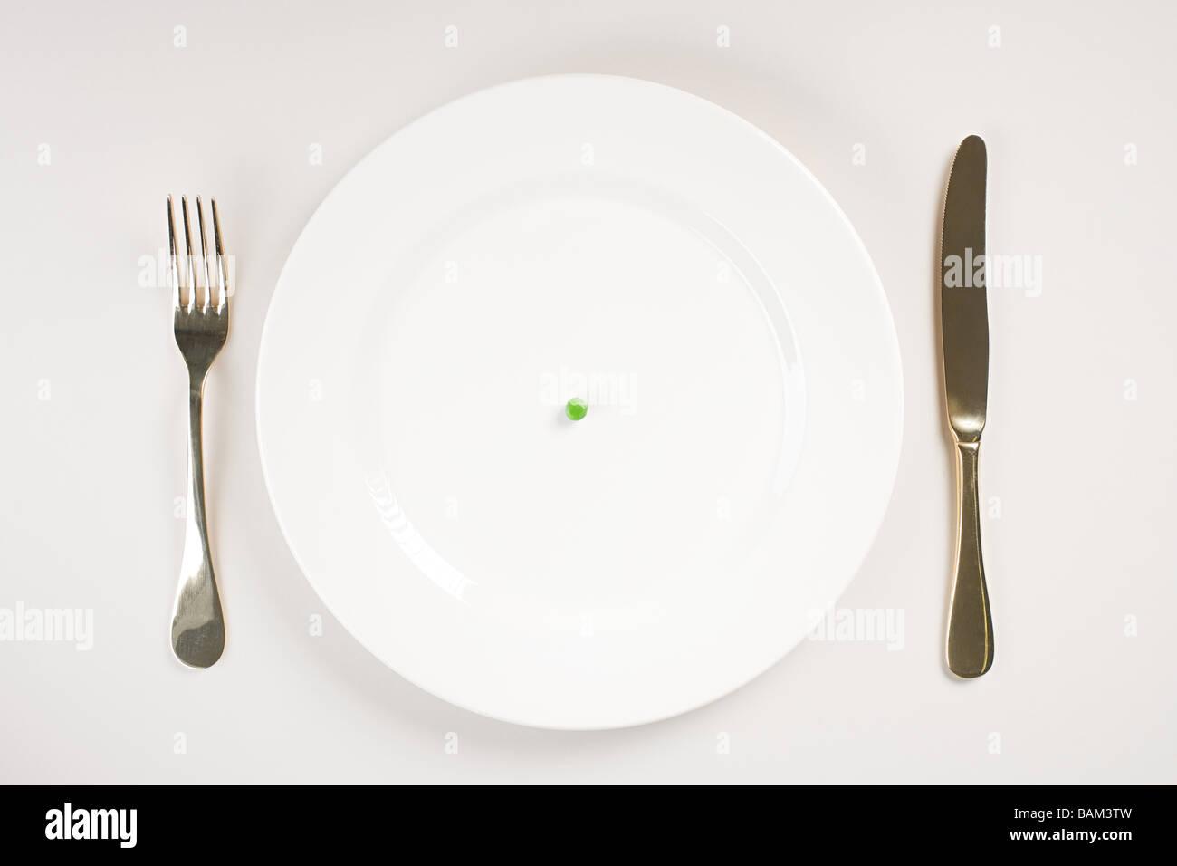 Eine Erbse auf einem Teller Stockbild