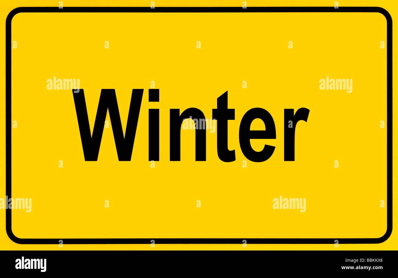 Ortsschild, Winter, symbolisch für den Anfang des Winters-Schriftzug Stockbild