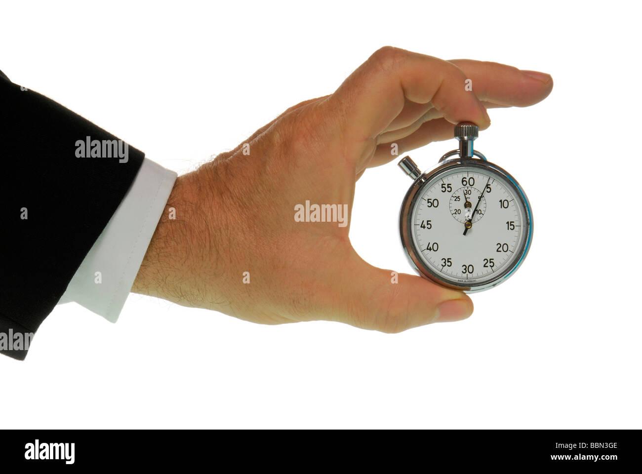 Manager-Hand mit Stoppuhr, ein symbolisches Bild für Zeitdruck Stockbild
