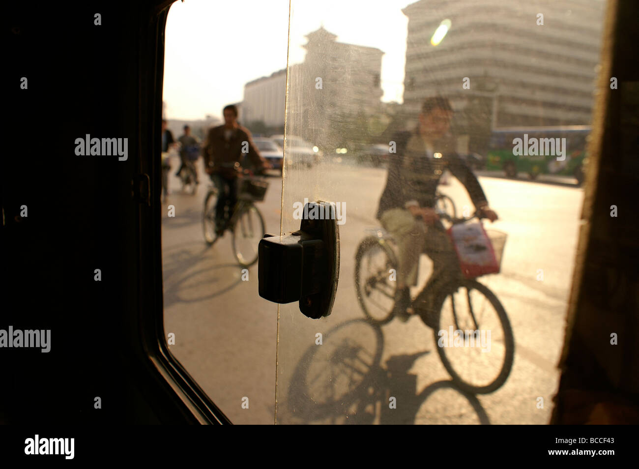 beijing china bicycle commuters in stockfotos beijing. Black Bedroom Furniture Sets. Home Design Ideas