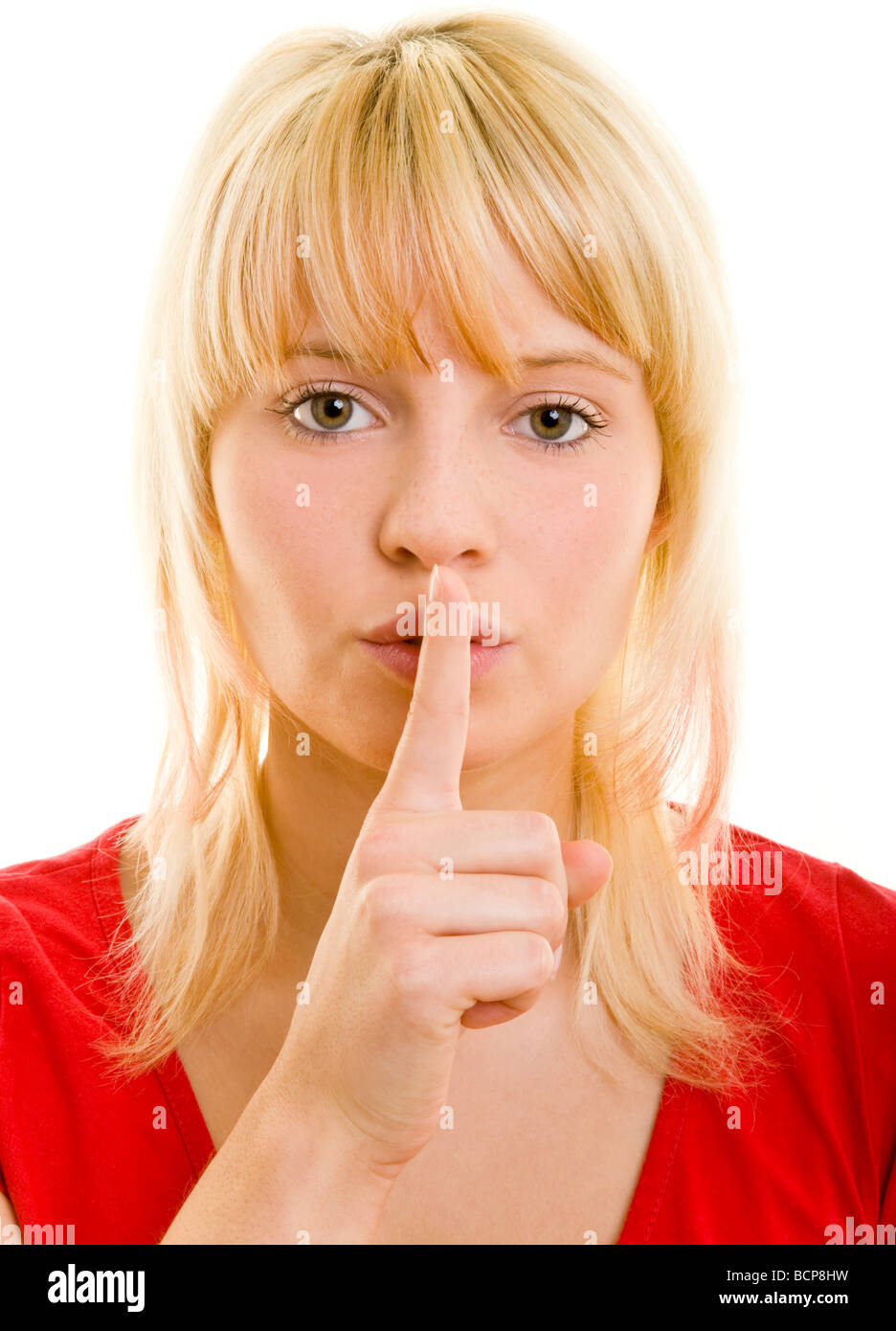 Junge Frau Legt Den Zeigefinger Auf Den Mund Stockbild