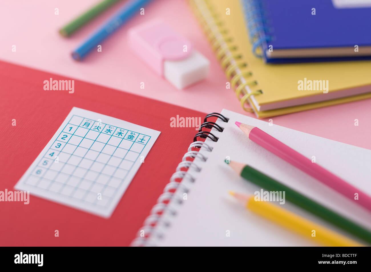 Notebook und Buntstift Stockbild
