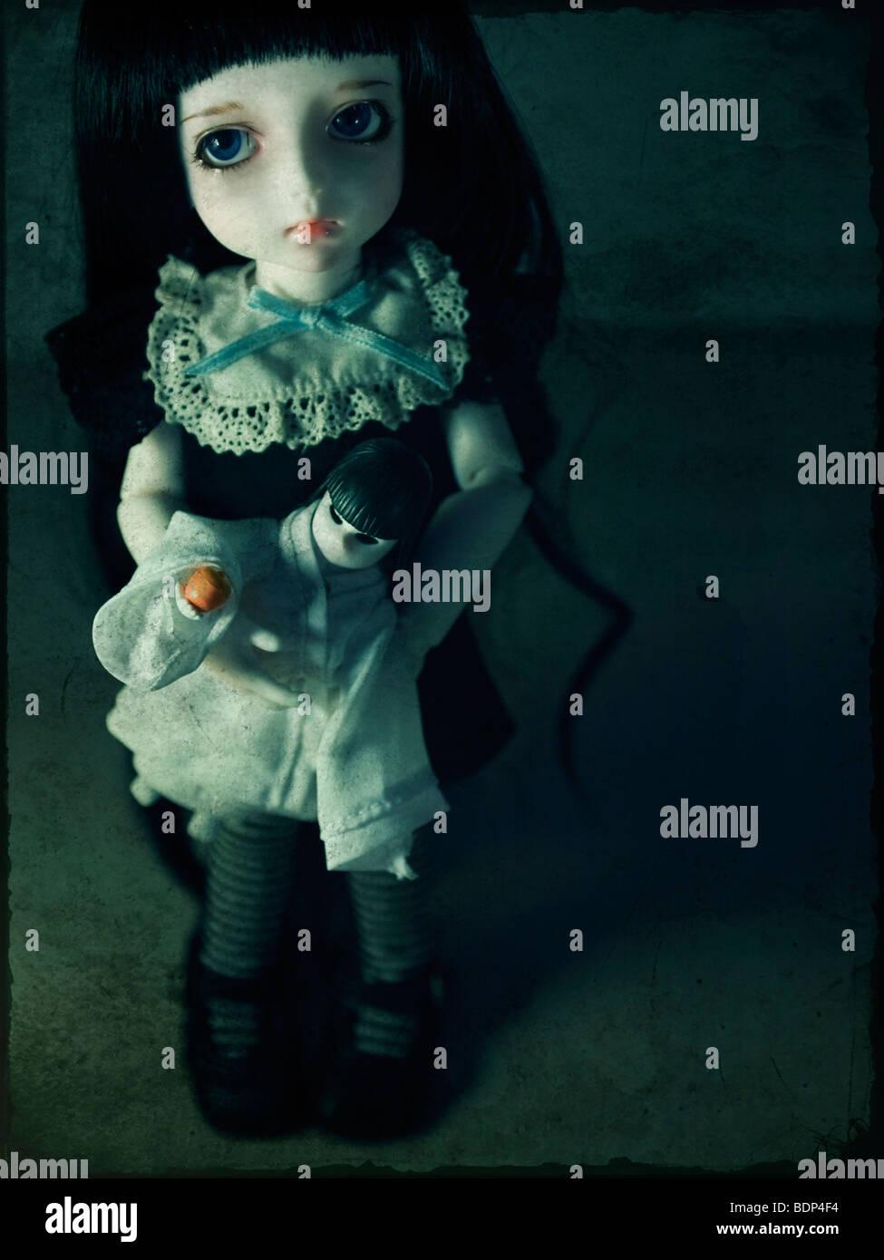 Eine traurig aussehende Puppe Stockbild