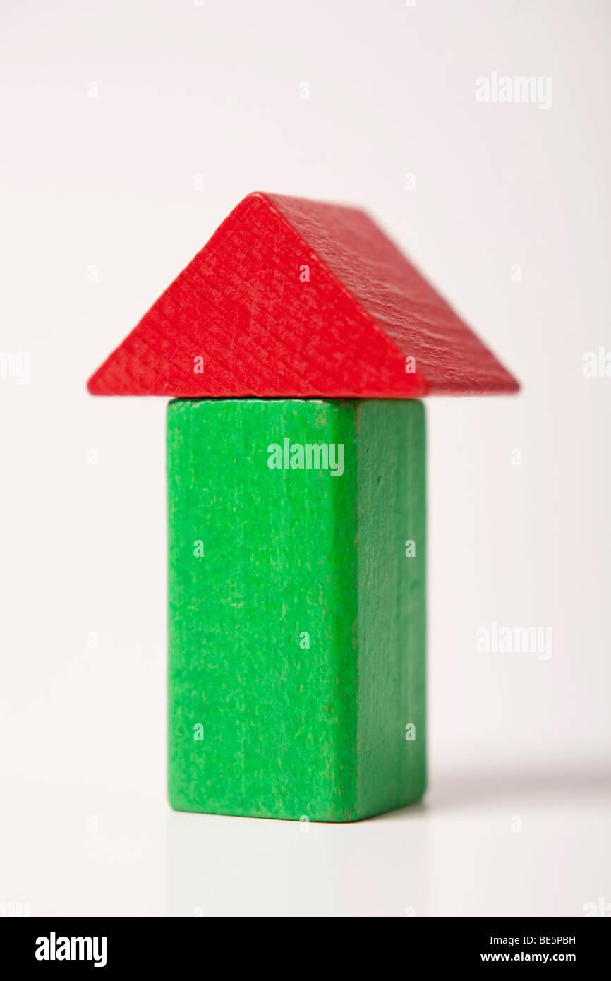 Grünes Haus, Bauen Von Backsteinen Aus Stockbild