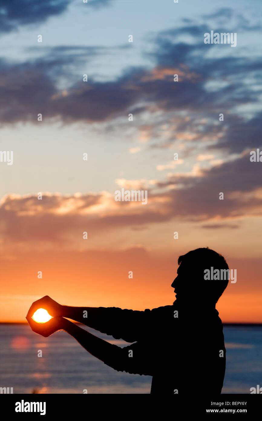 Person, die die Sonne. Stockbild