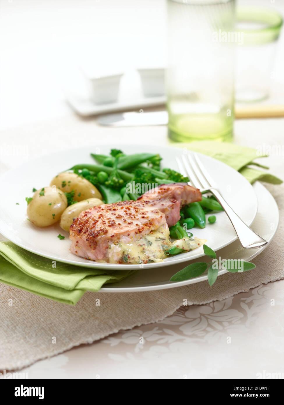 Schweinekotelett mit Honig-Senf-sauce Stockbild
