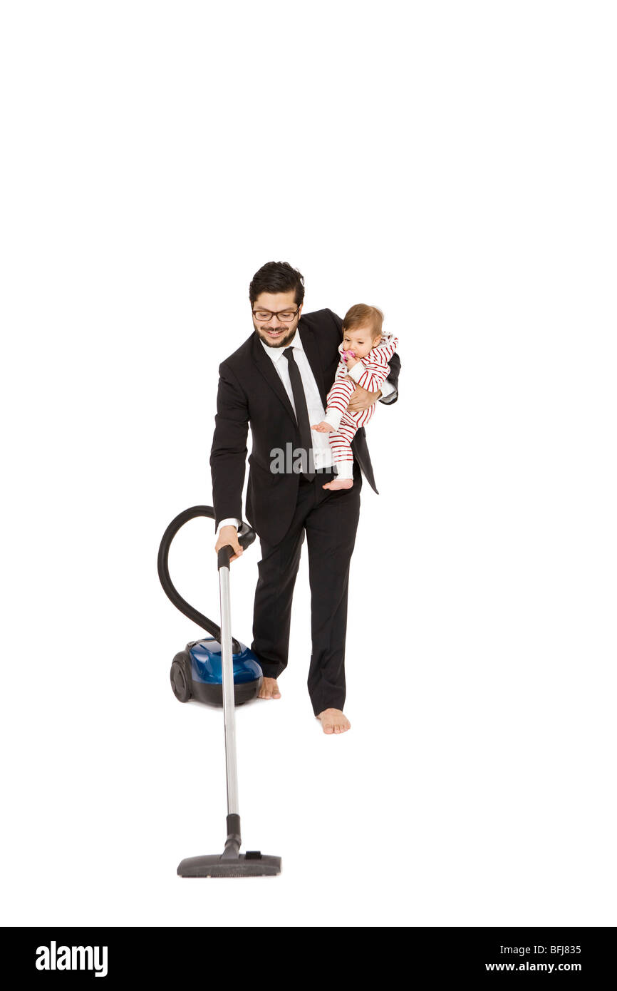 people vacuuming young stockfotos people vacuuming young bilder alamy. Black Bedroom Furniture Sets. Home Design Ideas