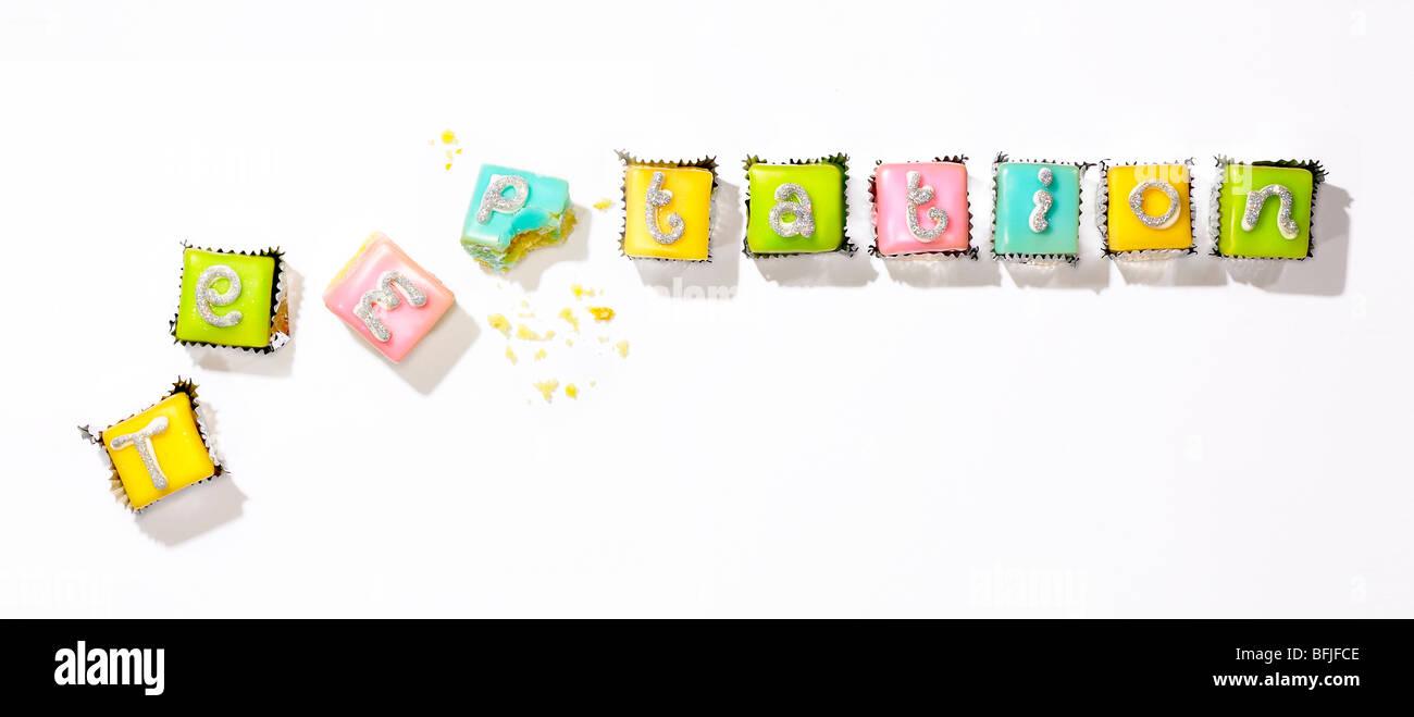 kleine Kuchen zur Veranschaulichung der Wort-Versuchung Stockbild