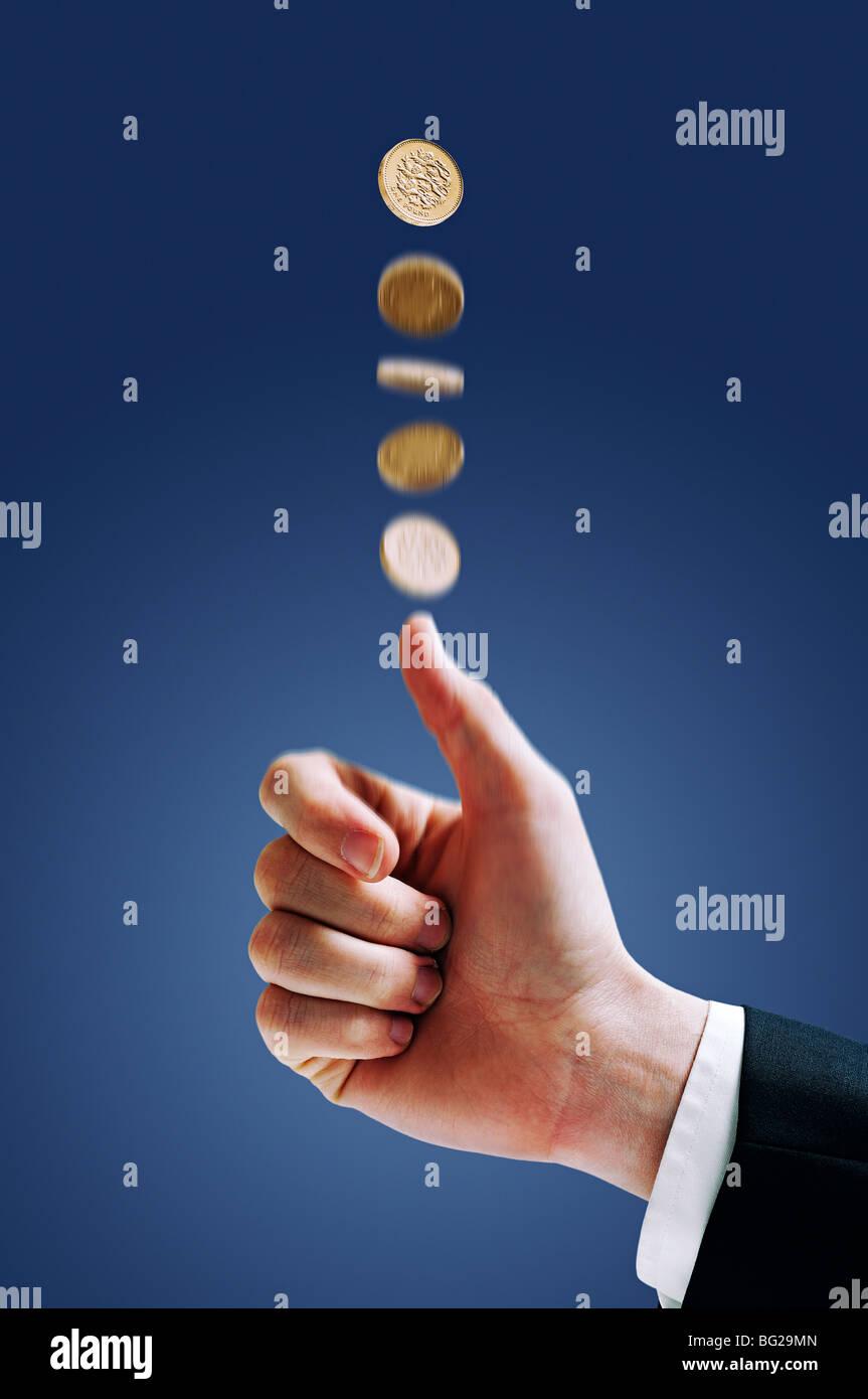 Eine Münze zu werfen Stockbild