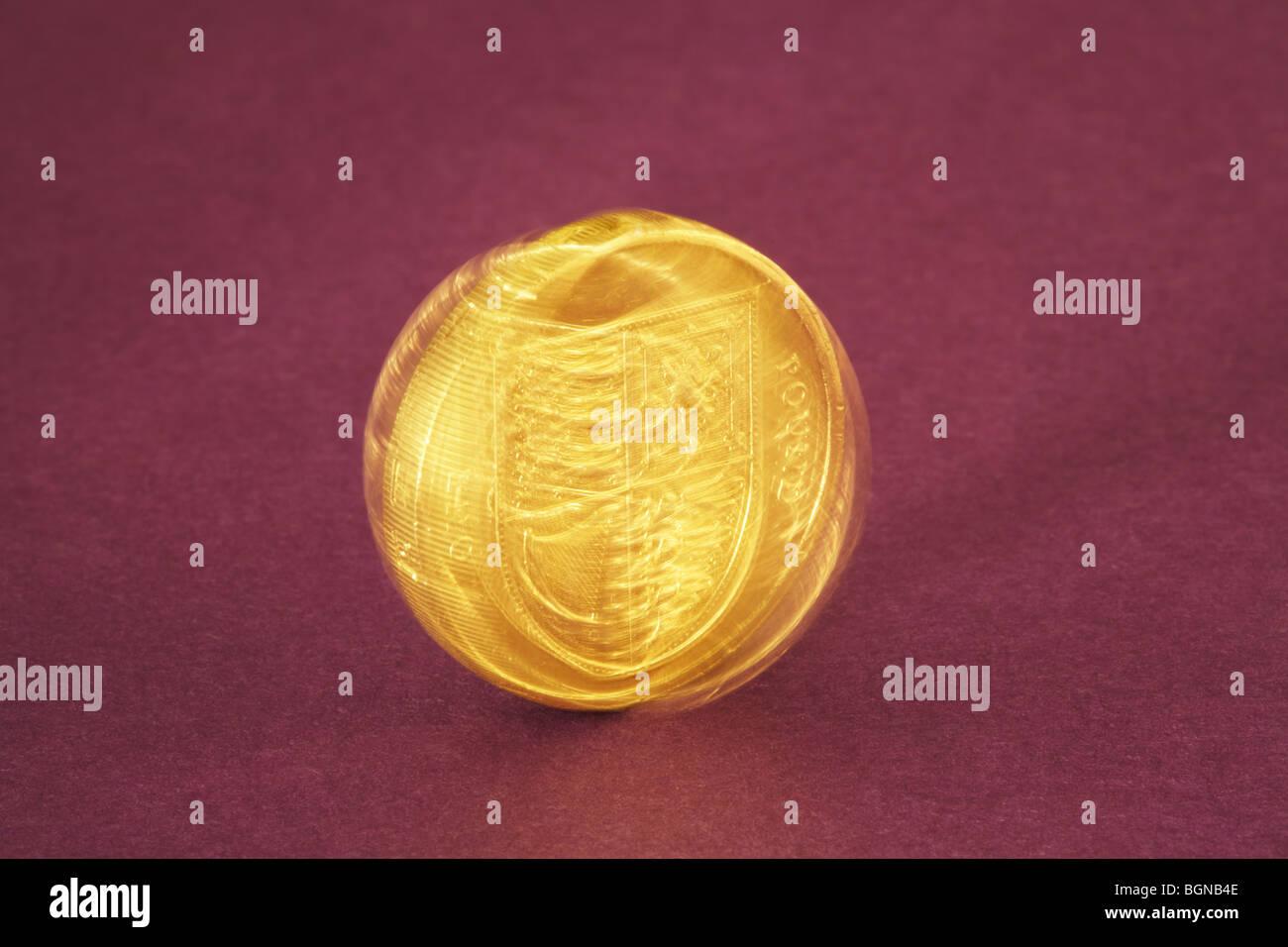 Dreht ein Pfund-Münze Stockbild