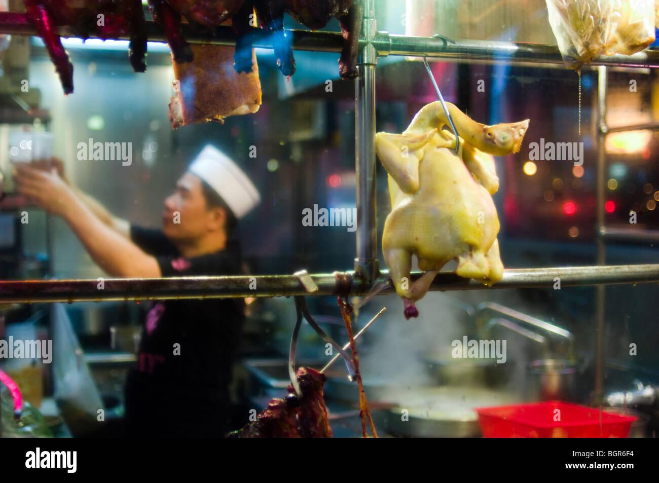 Eine Ente hängen im Fenster einer Chinatown Restaurant Küche. New ...