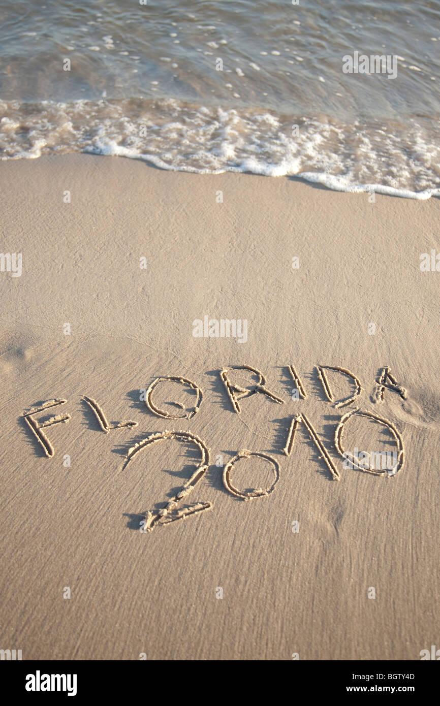 Text geschrieben am Strand Stockbild