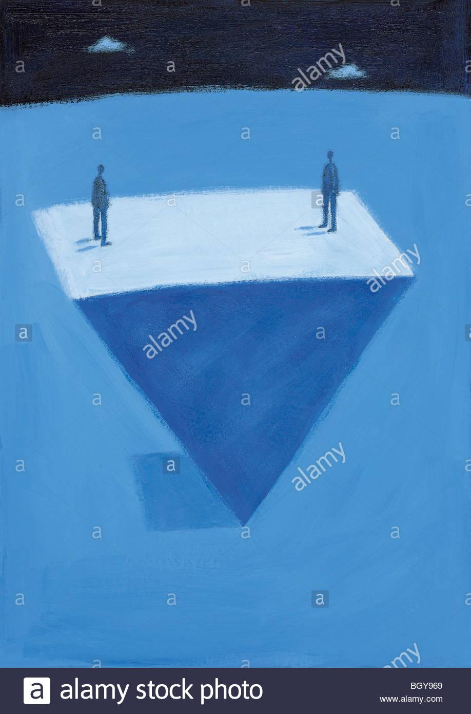 Menschen stehen auf dem Kopf stehend auf Dreieck Stockbild