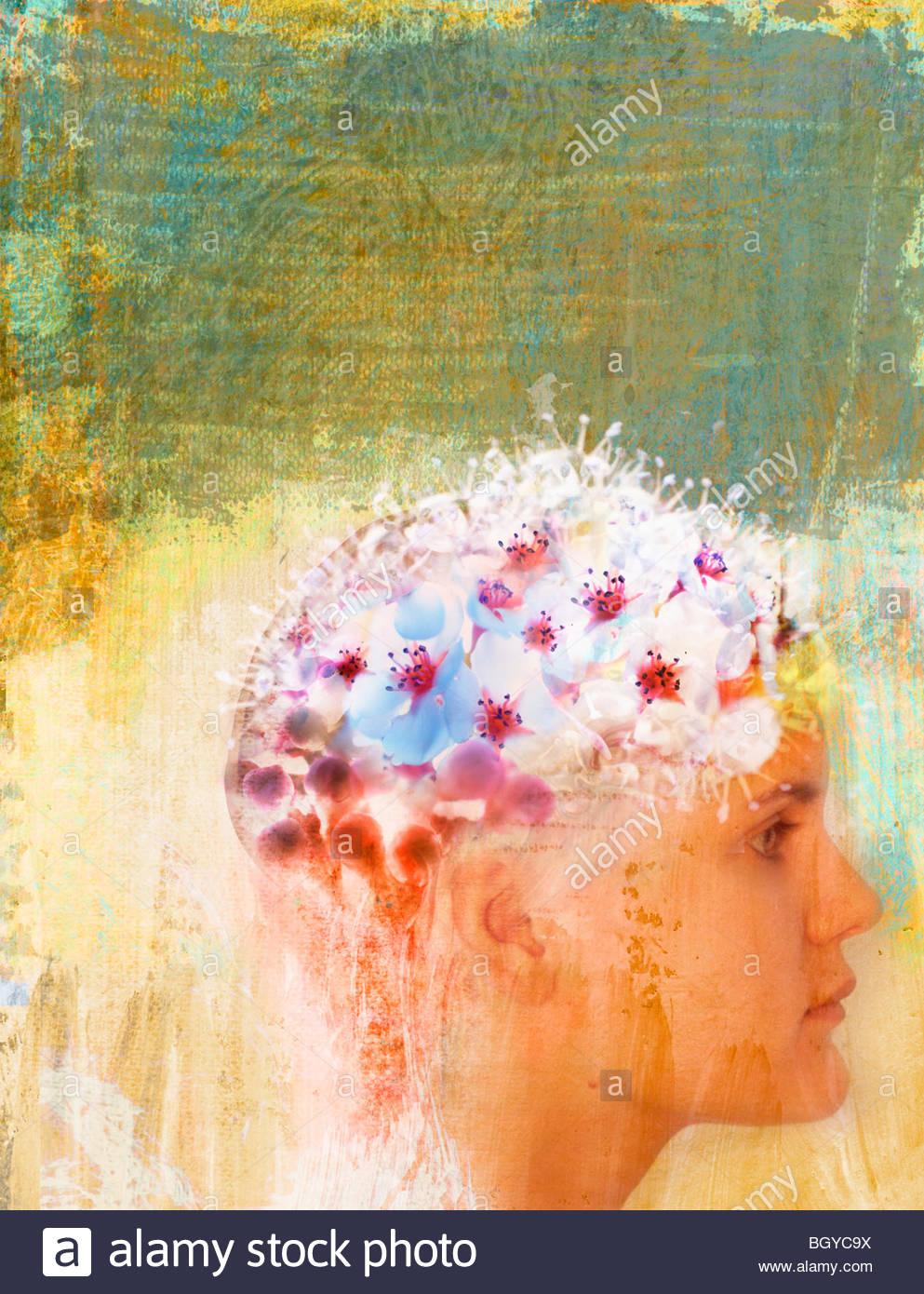 Frau mit Blumen auf Kopf Stockbild