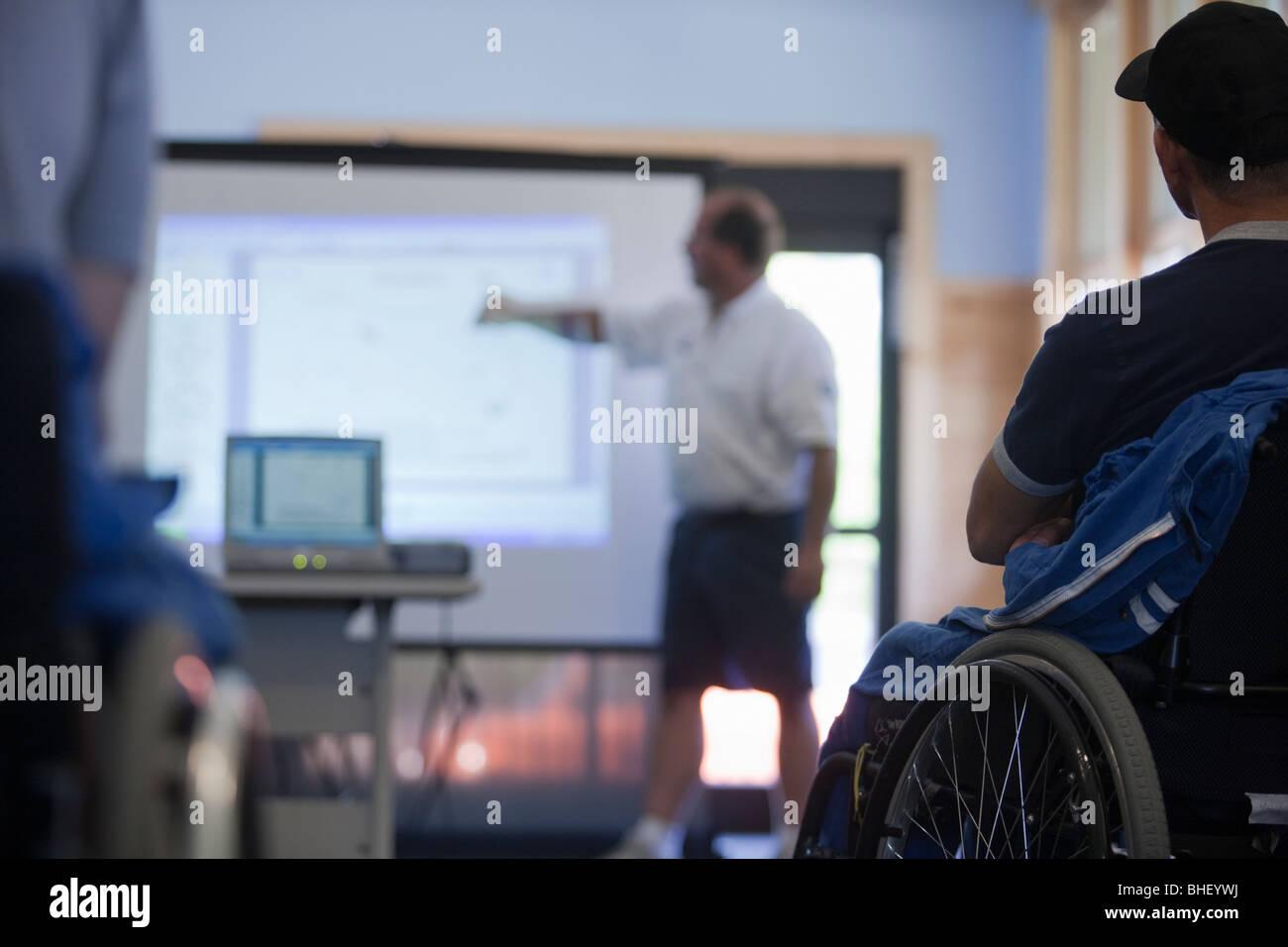 Behinderung Sport training Klasse Stockbild
