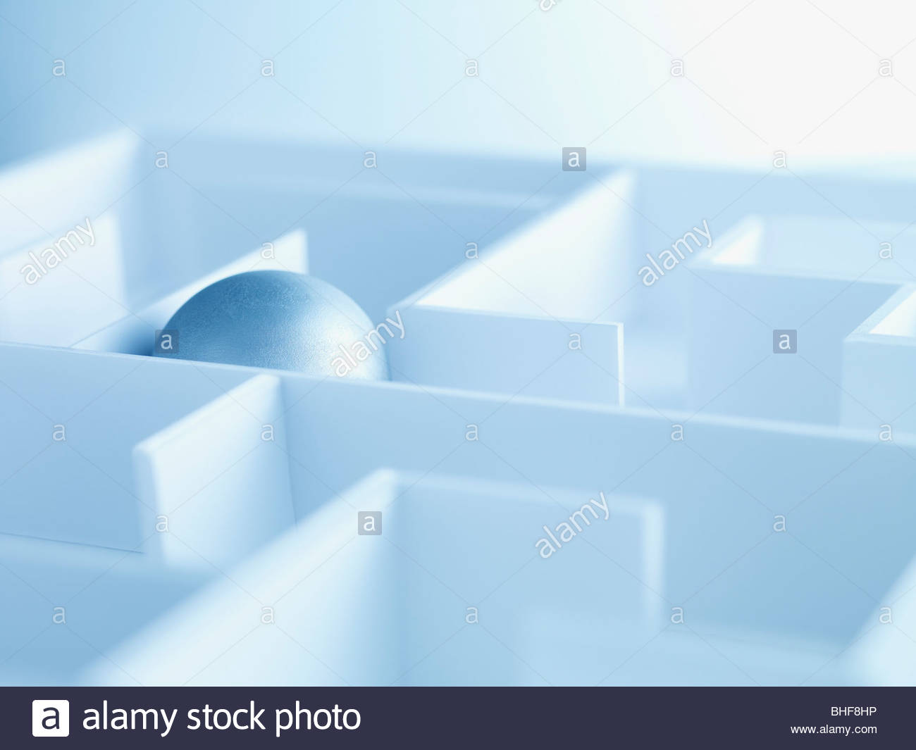 Ball gefangen im Labyrinth Stockbild