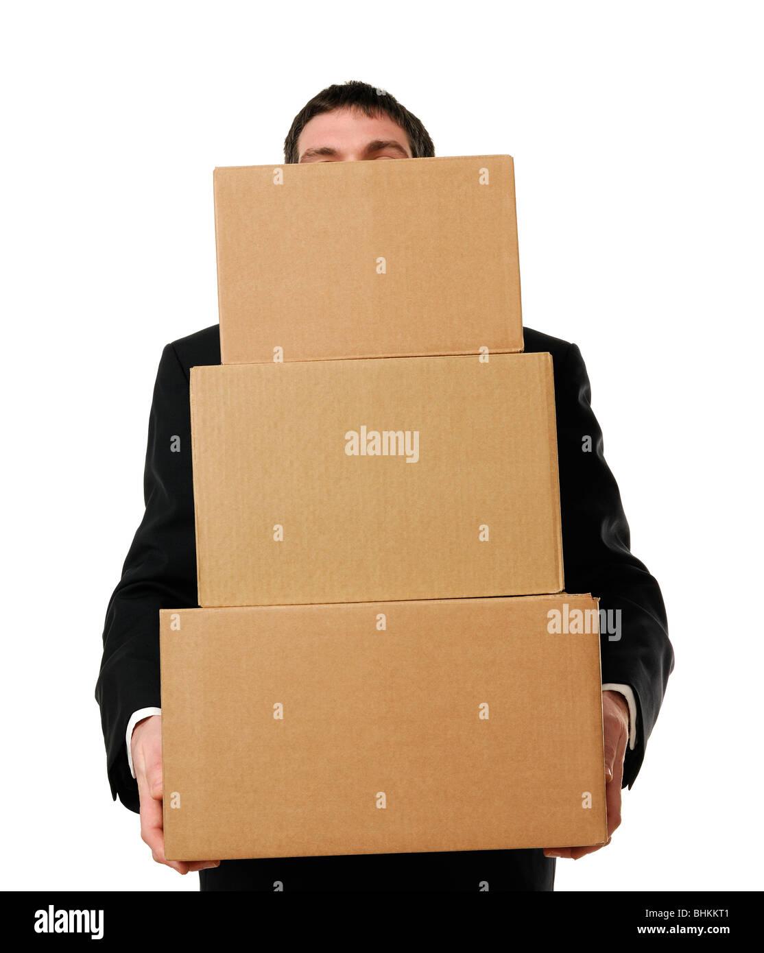 Geschäftsmann, überladen mit Boxen Stockbild