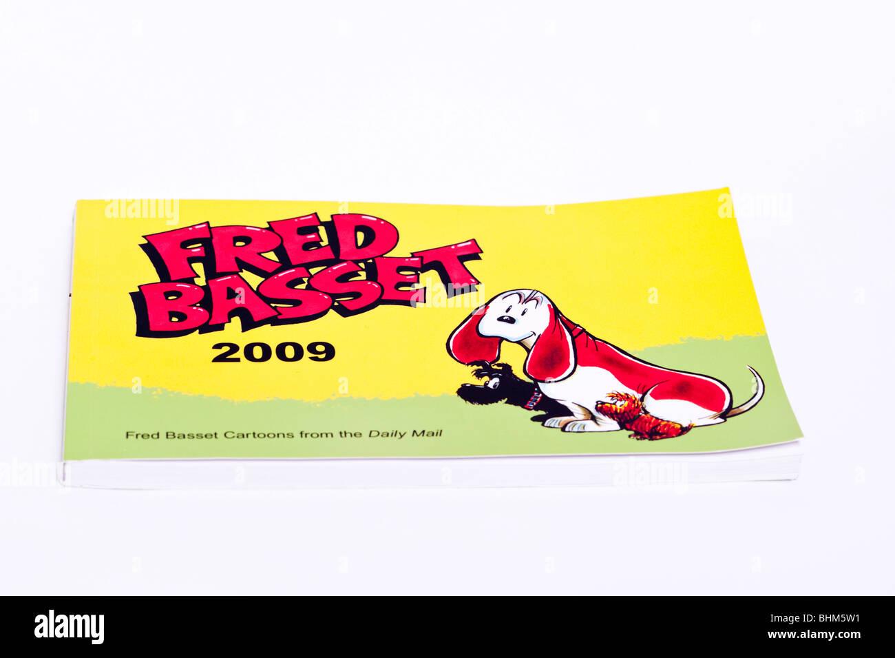 Ein Fred Basset-Cartoon-Buch auf weißem Hintergrund Stockbild