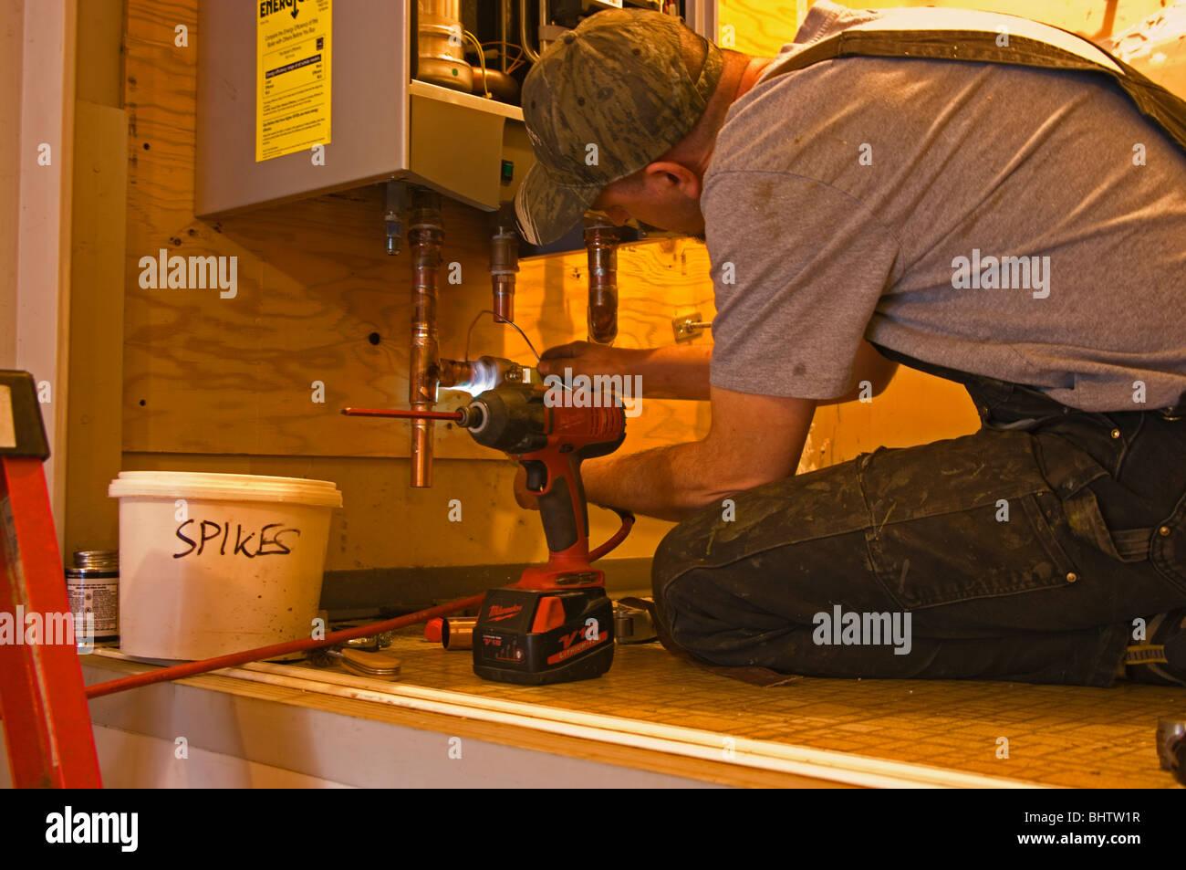 plumber stockfotos plumber bilder alamy. Black Bedroom Furniture Sets. Home Design Ideas