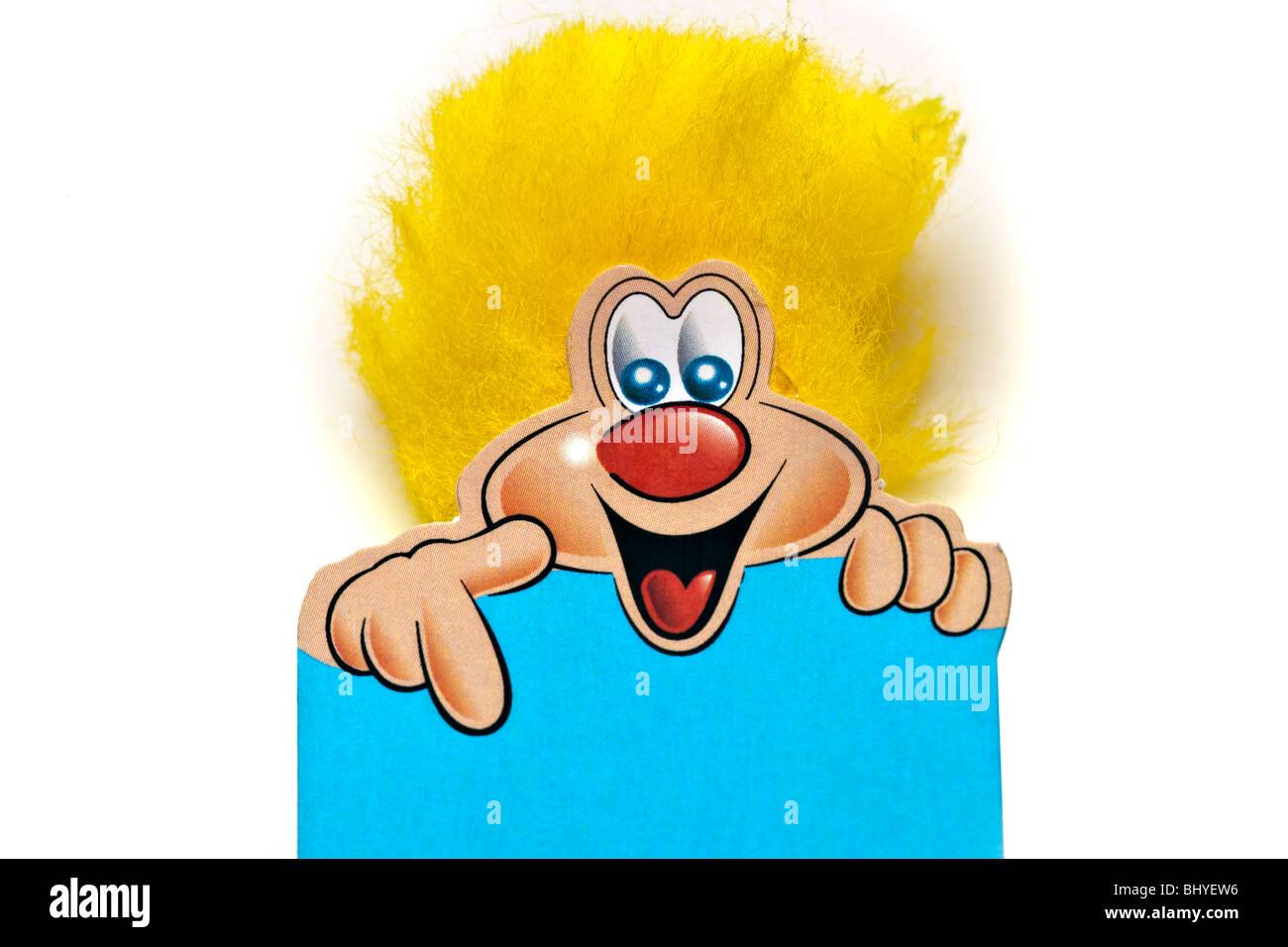 Lächelnd, gelbe buschig behaart Cartoon Charakter nach unten zeigt. Stockbild