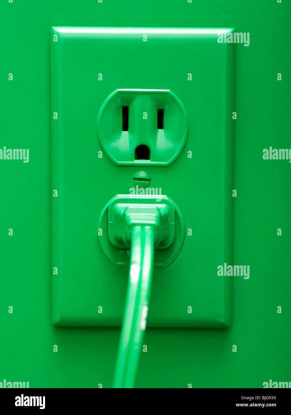 grüne Steckdose Stockbild