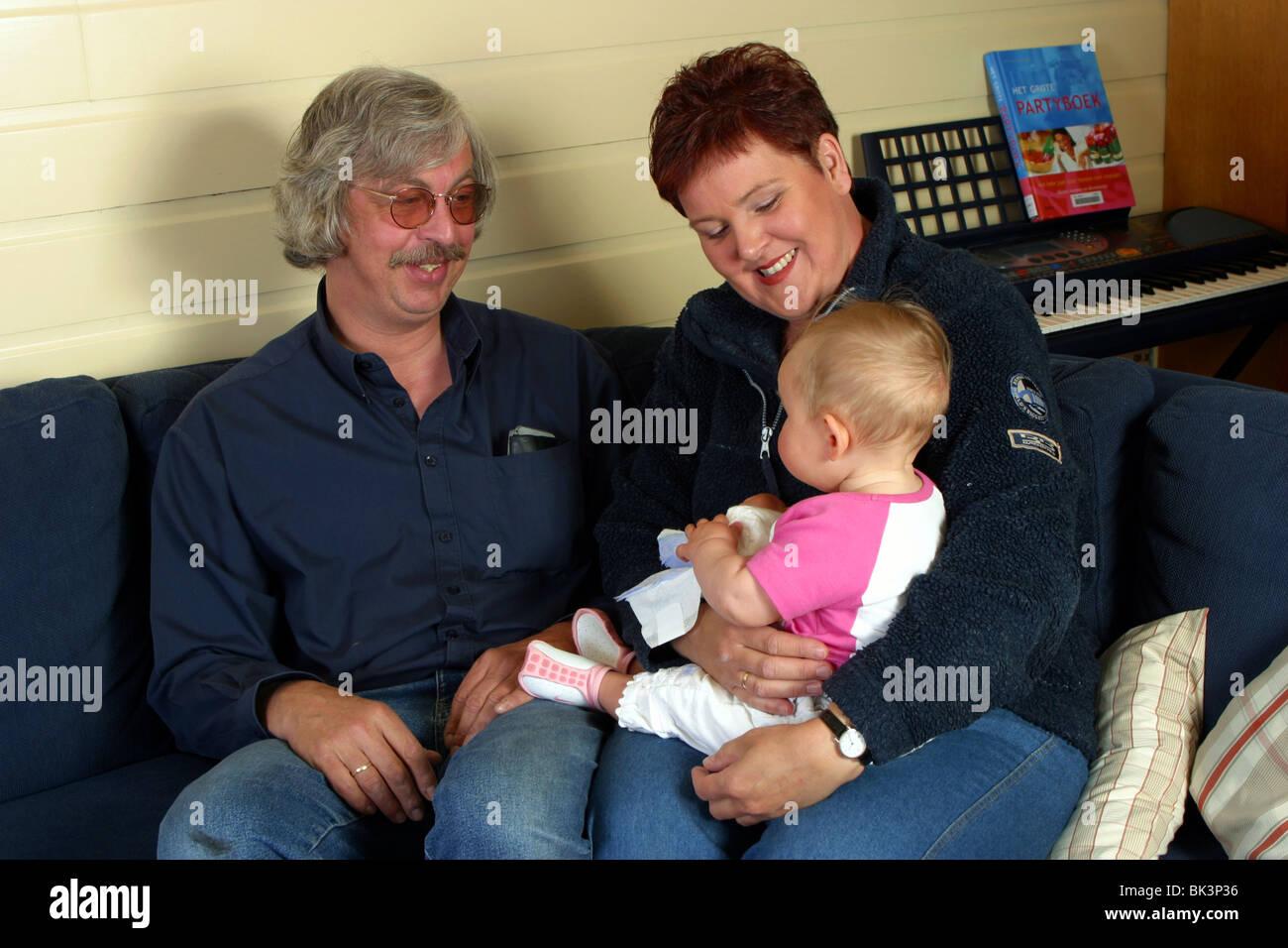 Älteres Ehepaar mit baby Stockbild