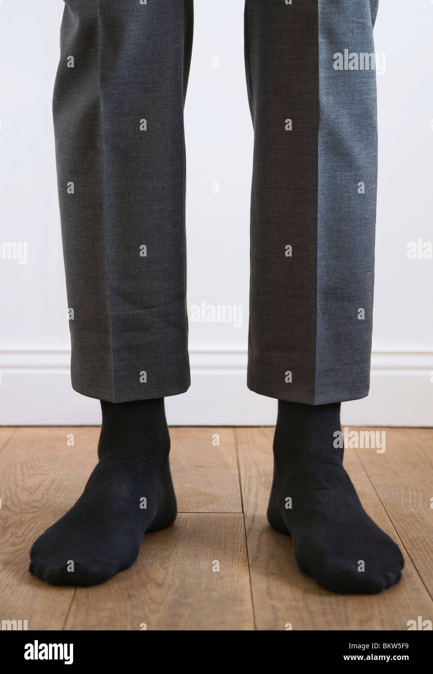 Mann ohne Schuhe Stockbild