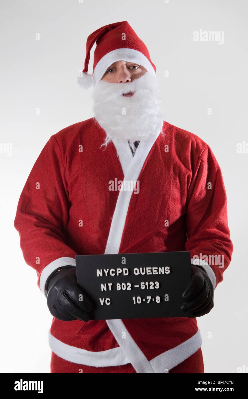Santa Claus posieren für ein Fahndungsfoto Stockbild
