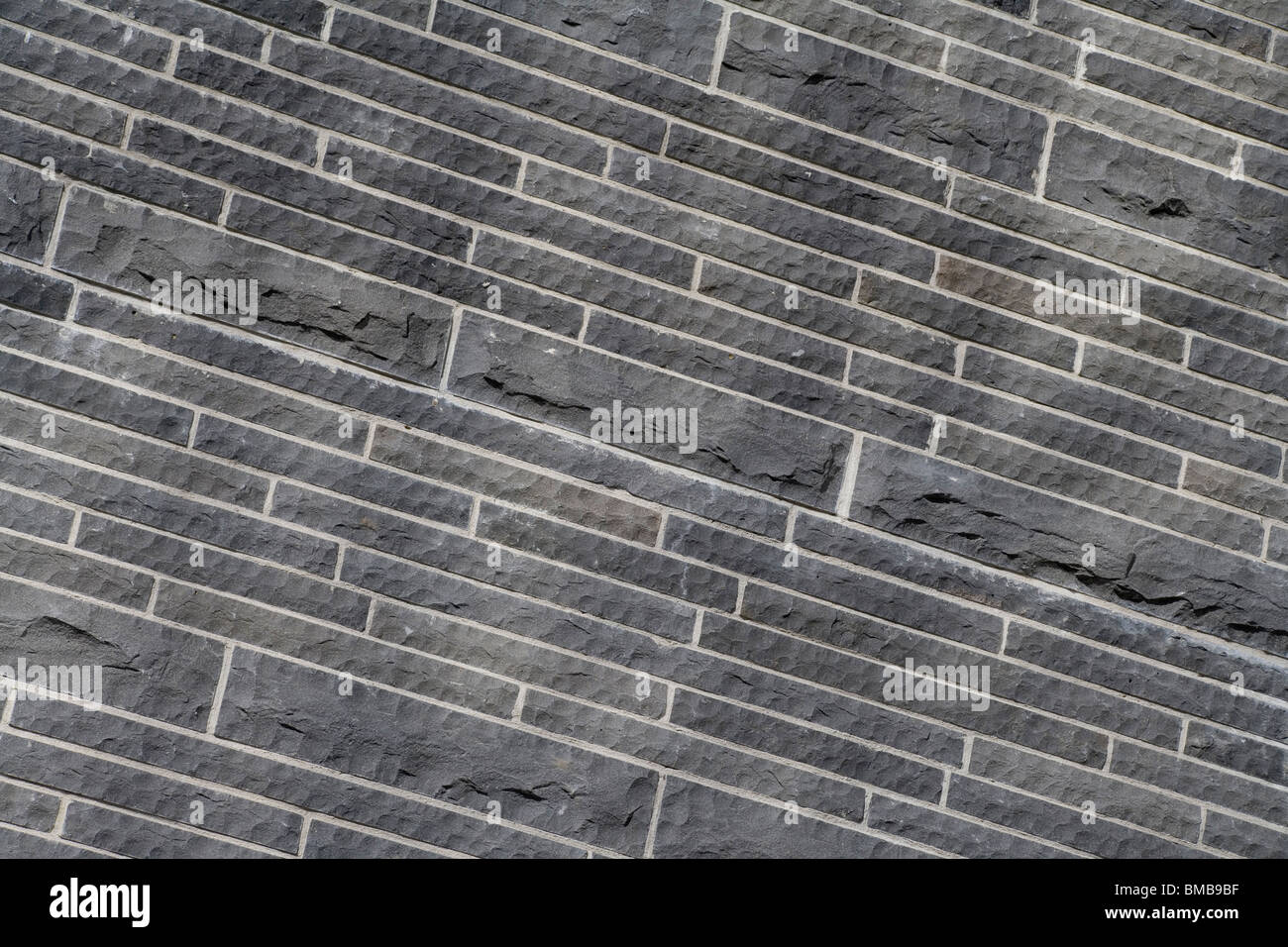 Steinmauer nahe für Hintergrund Stockbild