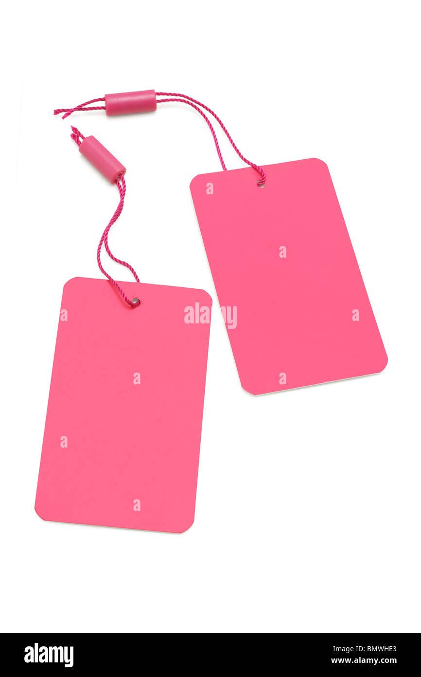 Rosa Papier Preisschild oder Beschriftung auf weißem Hintergrund Stockbild