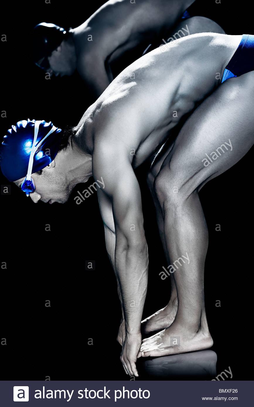 Schwimmer auf Startblock Stockbild
