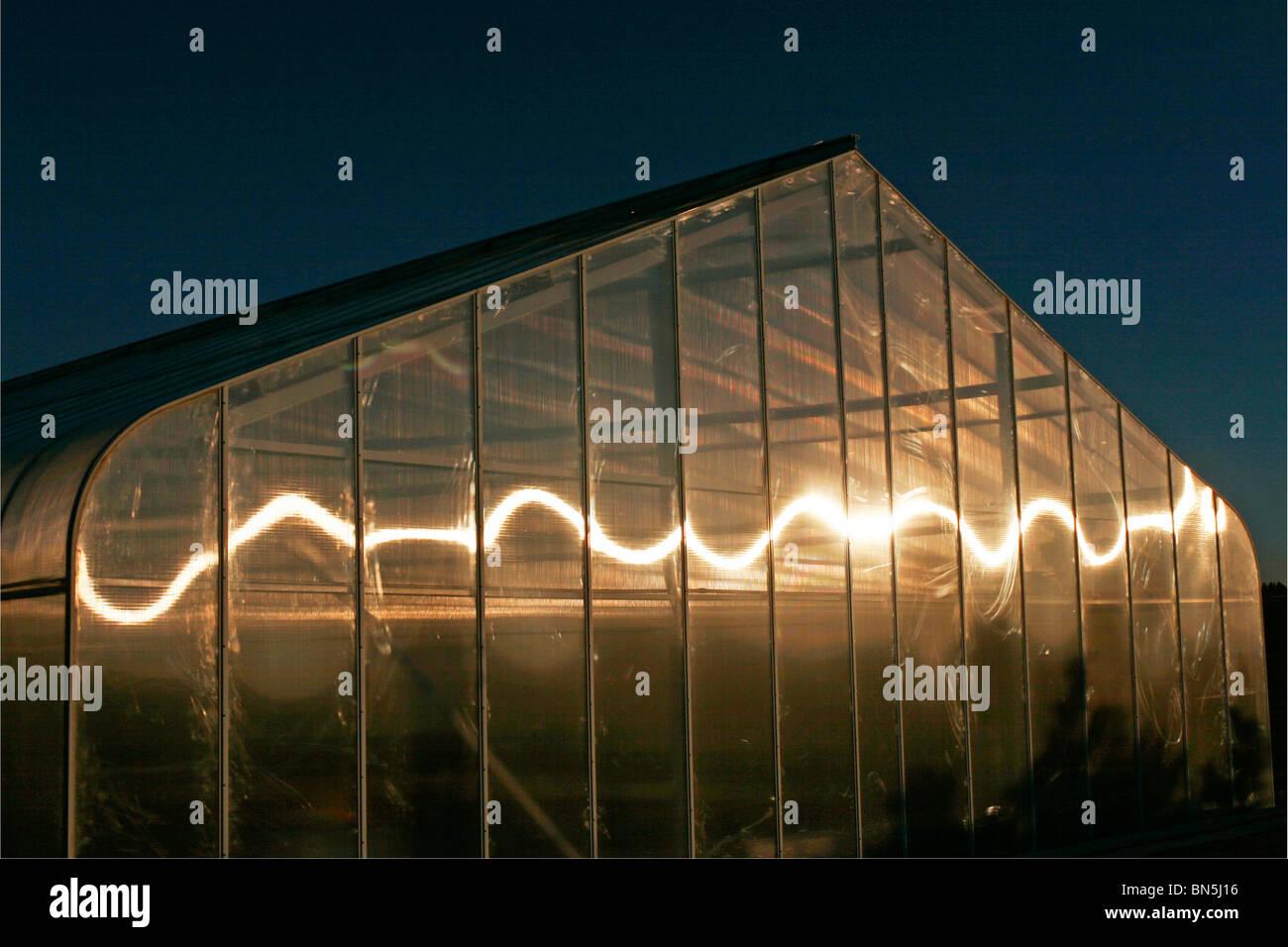 Gartengewächshaus mit Wirbel Reflexion Stockbild