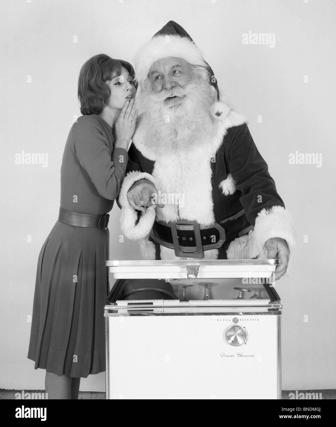 Frau, Flüstern, Santa Claus Stockbild