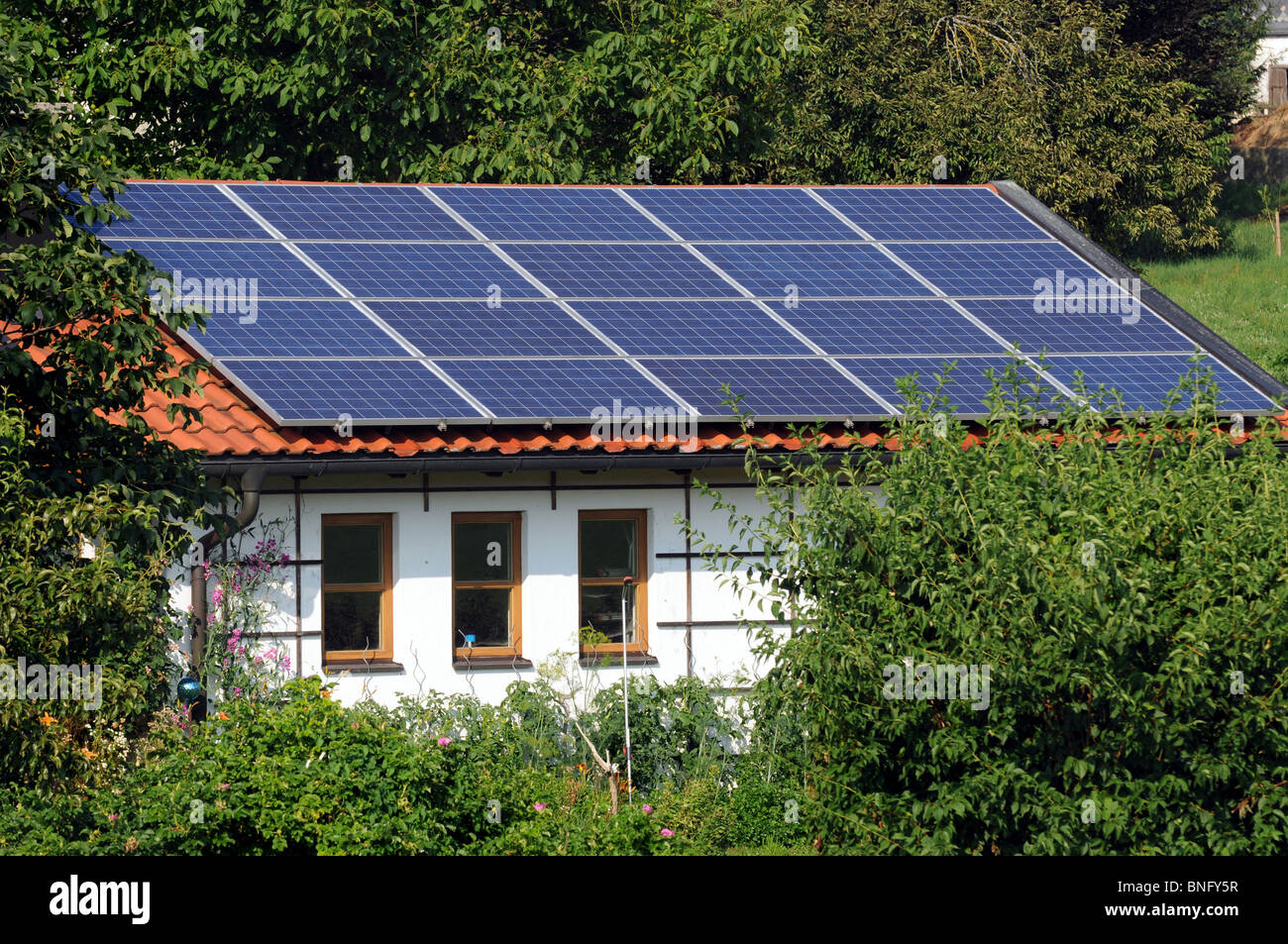 solar panel on roof garage stockfotos solar panel on. Black Bedroom Furniture Sets. Home Design Ideas