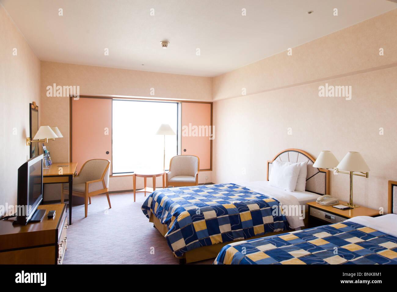 Hilton Hotel-Zimmer mit zwei Einzelbetten Stockbild