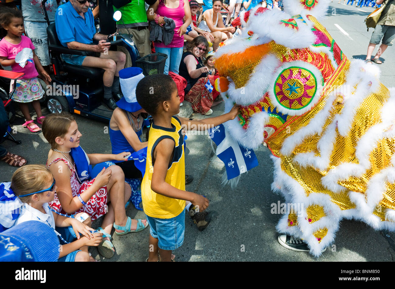 Chinesische Gemeinschaft feiert St. Jean Baptiste Tag in lebendigen multikulturellen Stadt von Montreal Kanada Stockbild