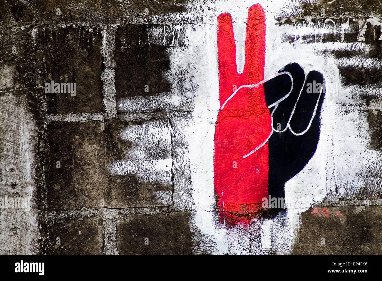 Das Sieg Symbol, Lackiert In Den Farben Schwarz Und Rot Der Sandinisten, An  Der Wand In San Juan Del Sur, Nicaragua.