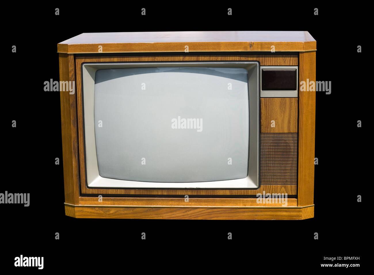 Altmodischer Fernseher mit schwarzem Hintergrund Stockbild