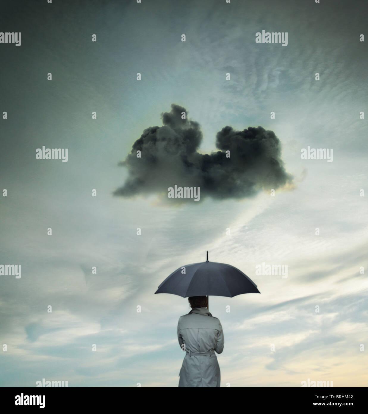 Business-Frau mit einem Regenschirm Stockbild