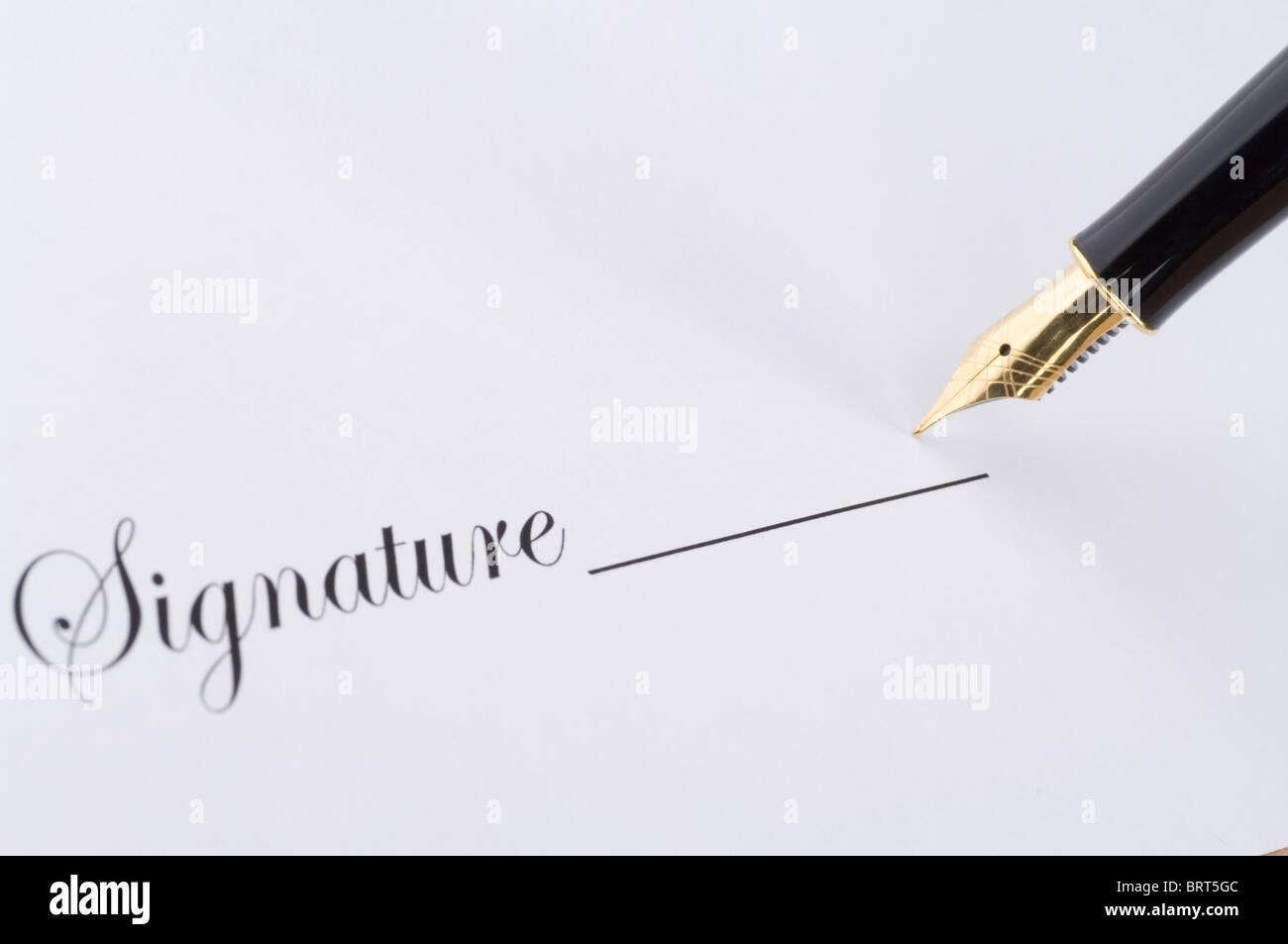 Signatur mit gold Stift Stockbild