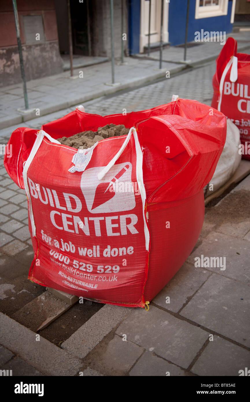 große Säcke mit Sand bauen Centre, UK Stockbild